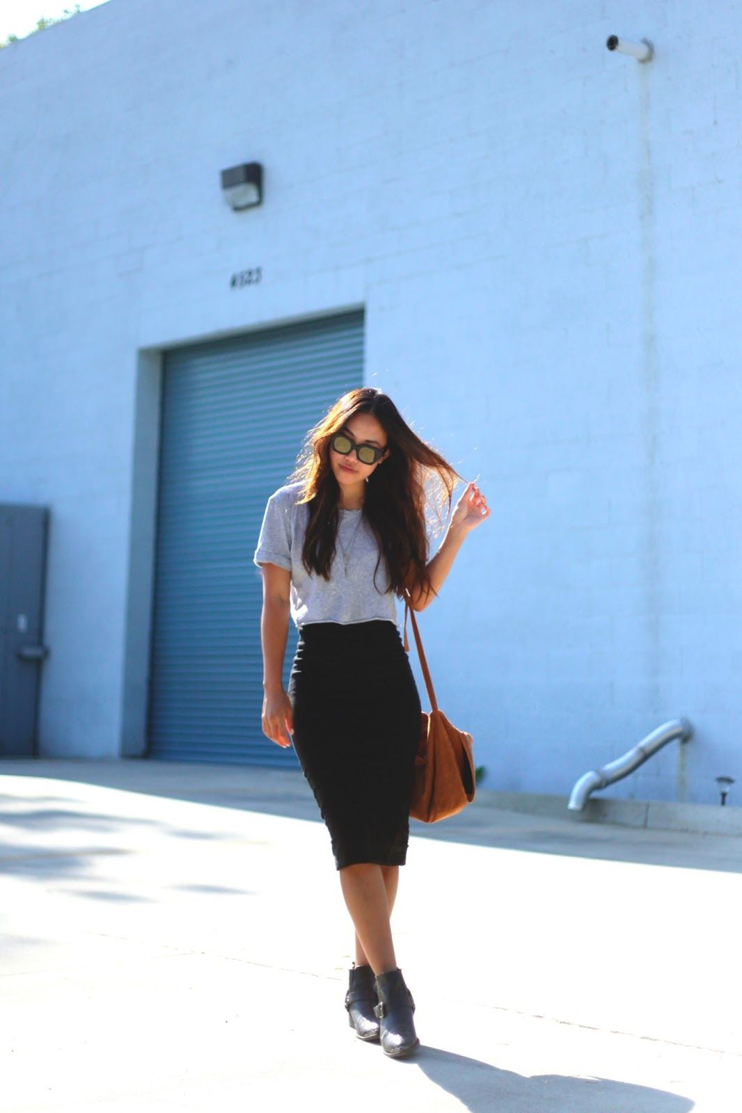 She wore this in summer, but this is a perfect fall look; love the crop top + high waist pencil skirt combo.