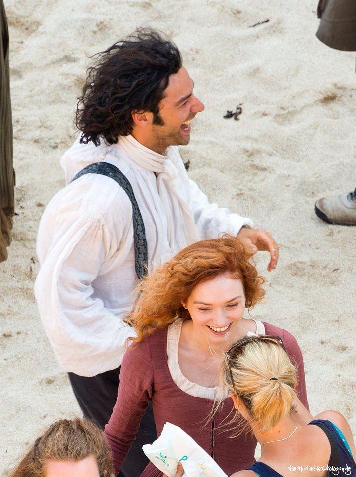 Aidan Turner and Eleanor Tomlinson during filming of Poldark...Aidan giggling as usual
