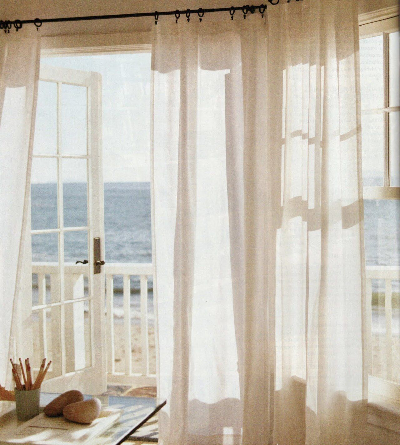 Breezy Home Office...Sheer Curtains And French Doors Leading Out To Beach  House Balcony Looking Over The Sand And Ocean.