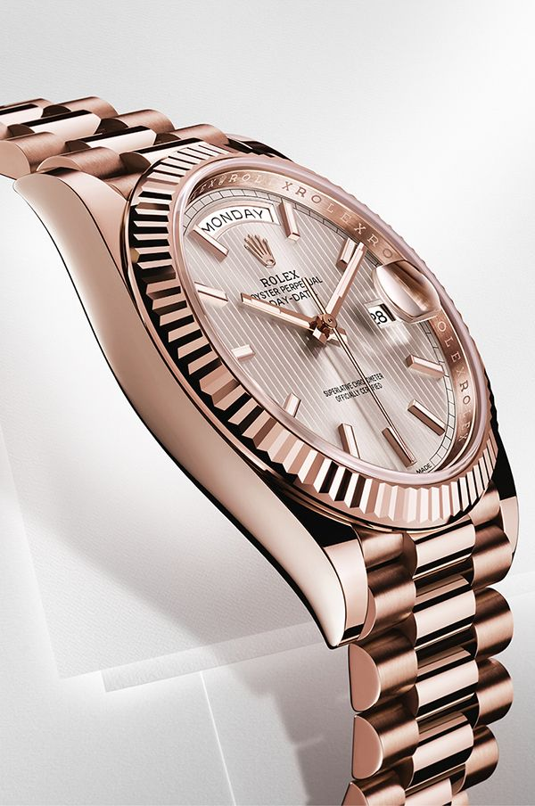 e71373654 Rolex Day-Date 40 in 18ct Everose gold with a fluted bezel, sundust dial  with stripe motif and President bracelet.