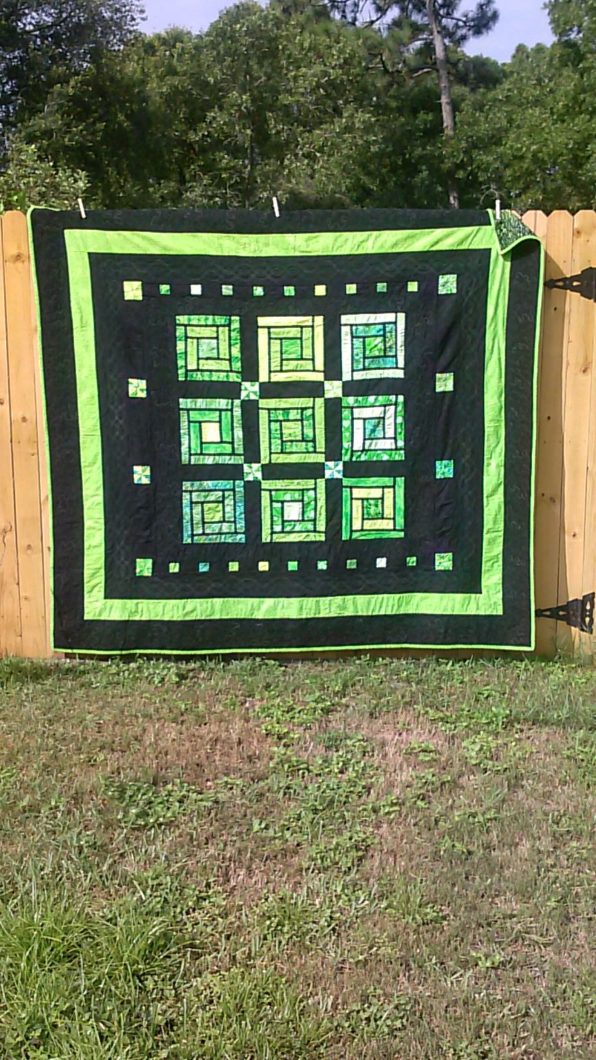 Cabin Windows Quilt in greens. Peace, Robert from