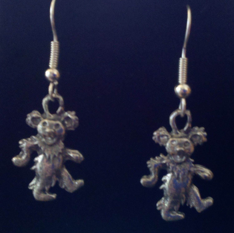 Silver Pewter Grateful Dead Hippie Earring. $4.00, via Etsy.