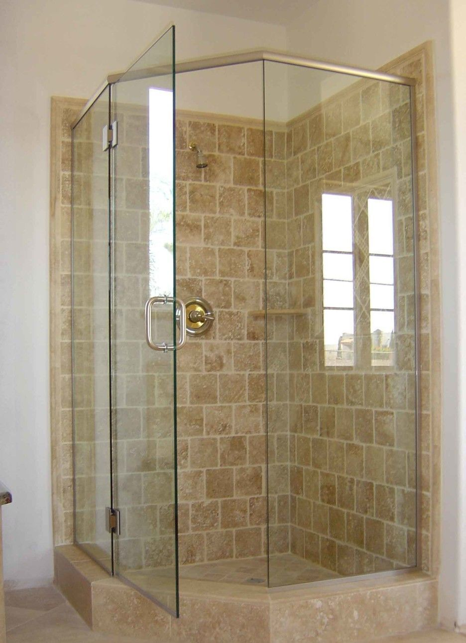 Bathroom. curved shape glass shower stall with metal door