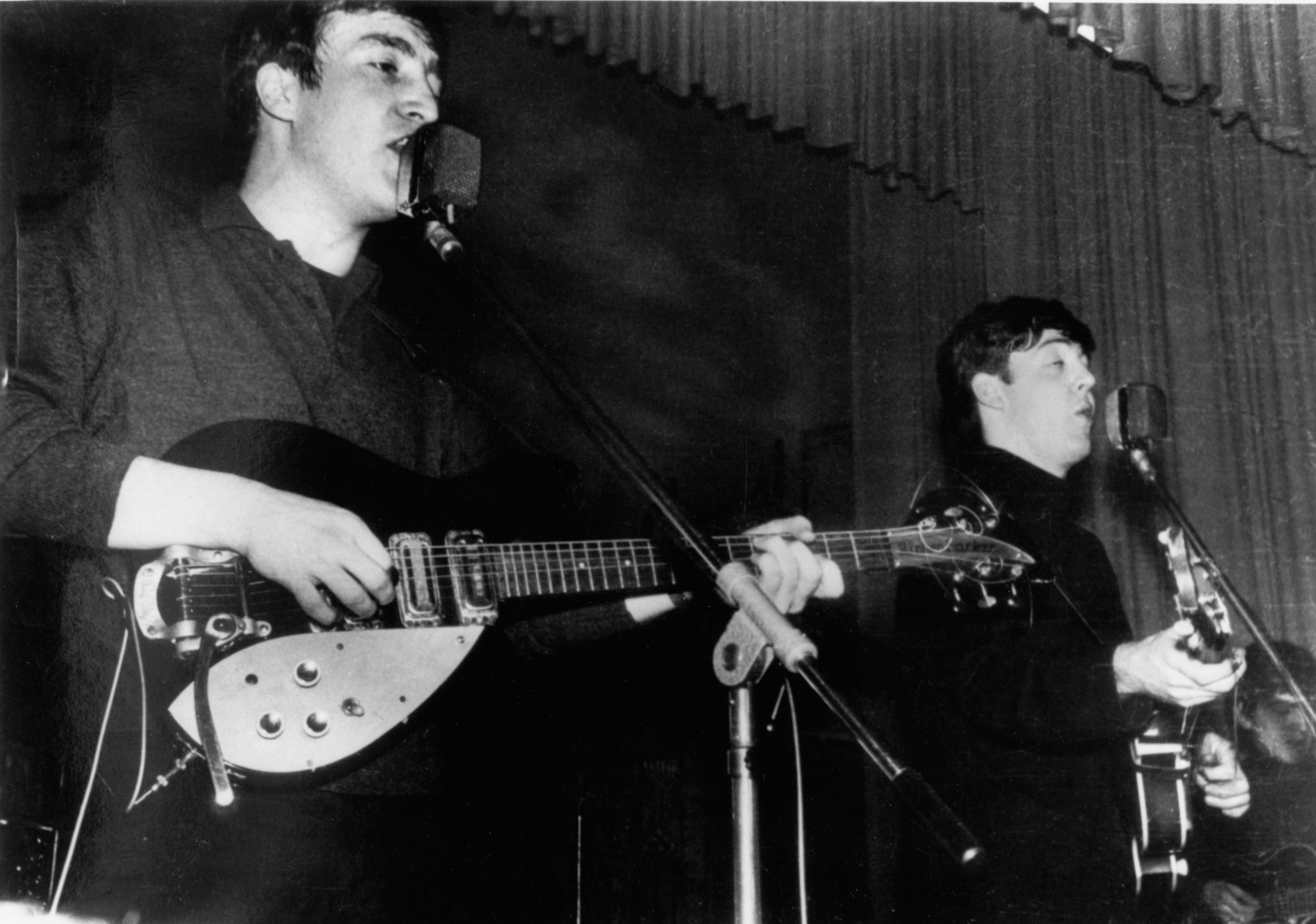 John Lennon Playing His First Rickenbacker 325 Guitar With Bigsby Vibrato Paul McCartney And George Harrison Of The Beatles Perform Live Onstage Circa