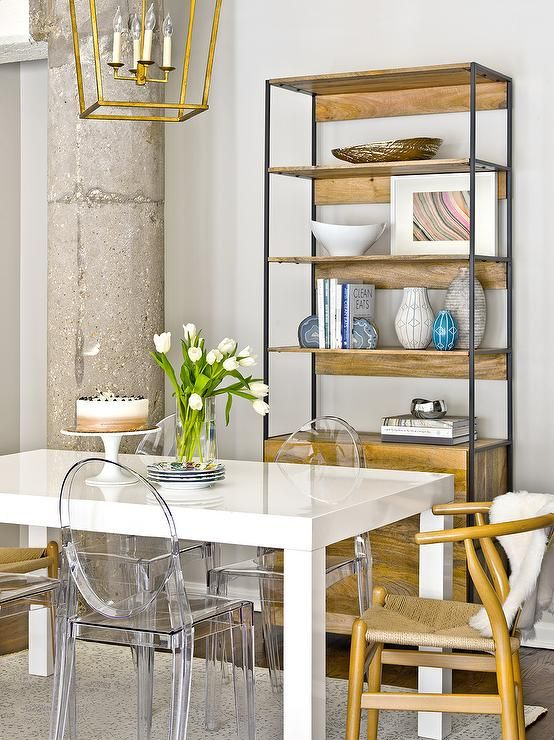 A Darlana Medium Lantern hangs over a West Elm Parsons Dining Table