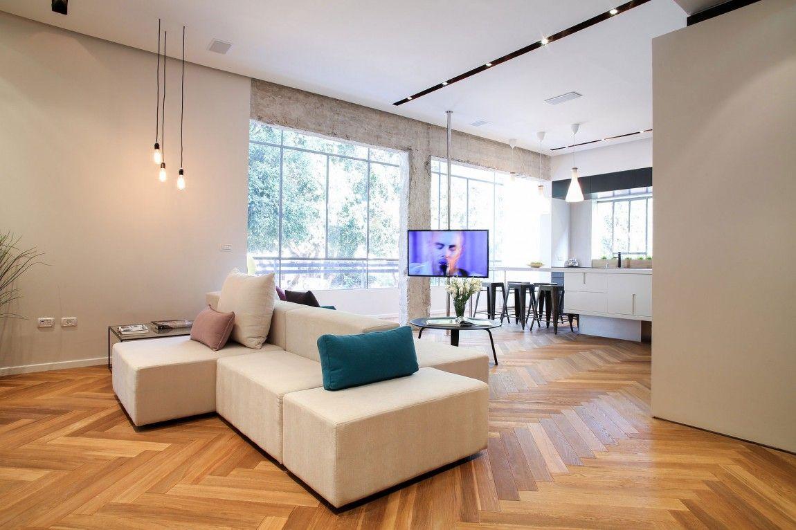 Herringbone floors and concrete columns linked by modern minimalism