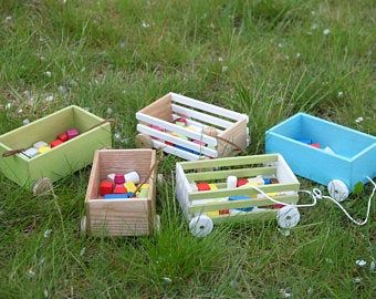 Wooden wagons. Miniature wooden toys. Wooden toys
