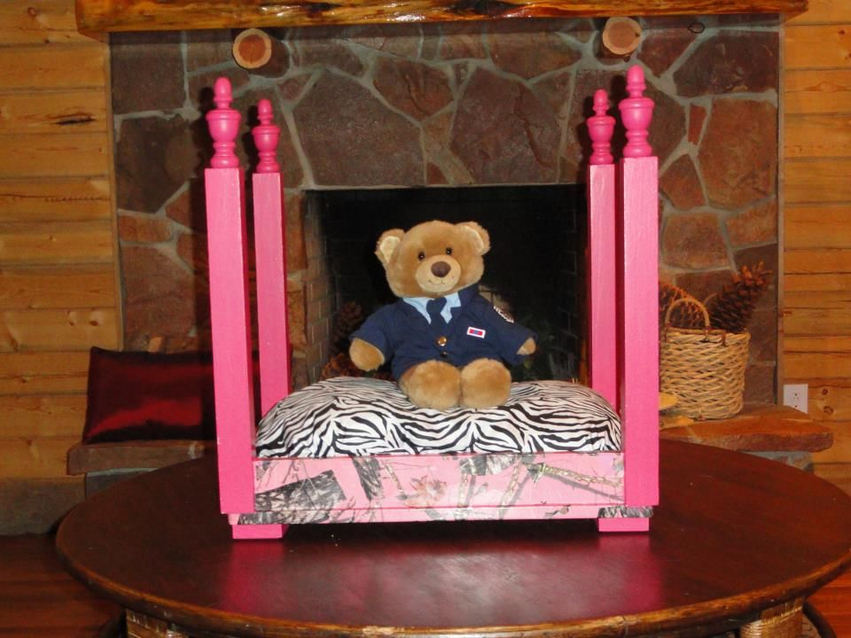 Pink Cammo Pet Bed from an end table.