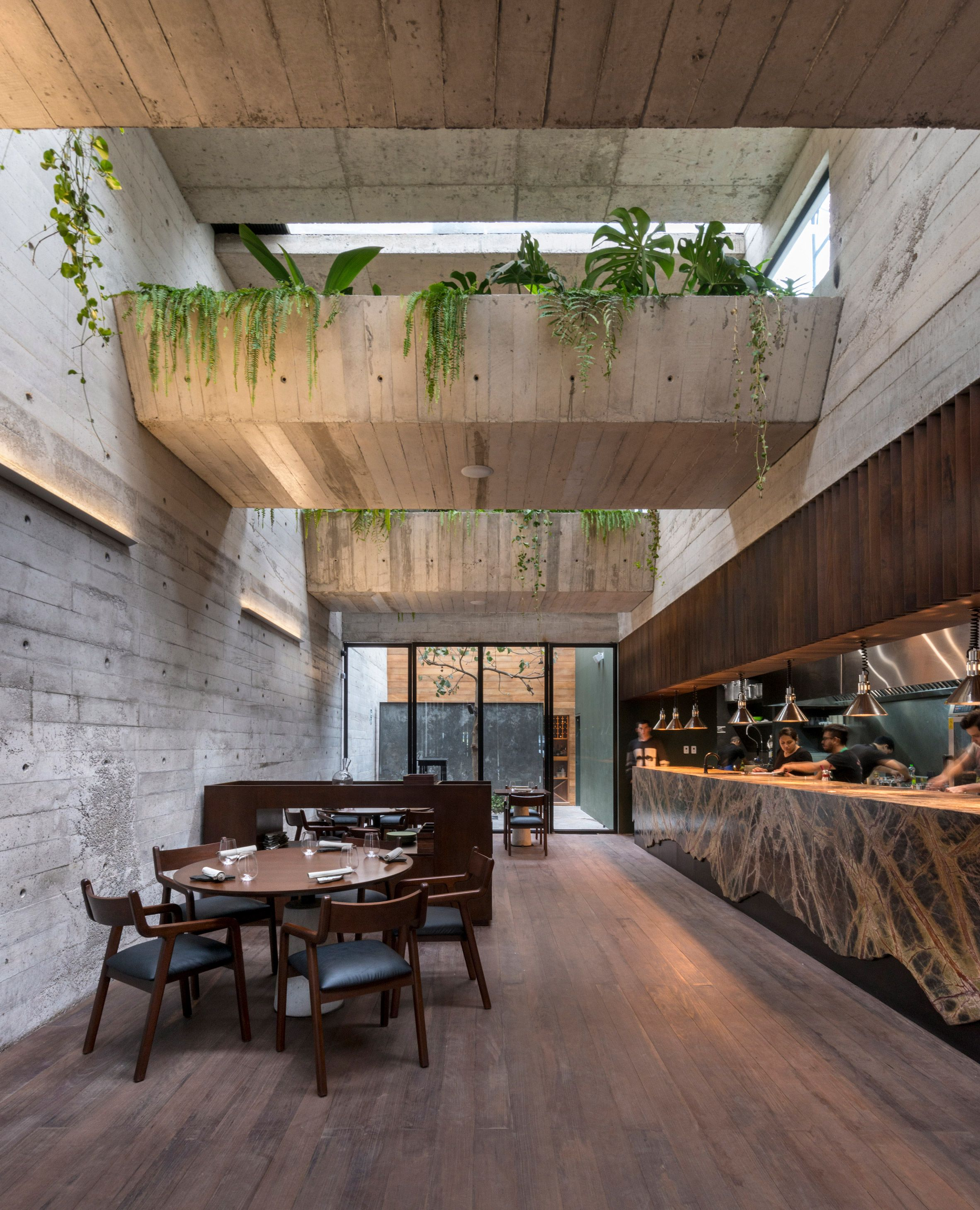 A rooftop garden and concrete beams filled with green ...