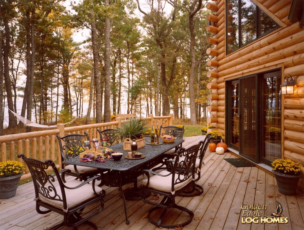 Log home by golden eagle log homes rear deck custom for Log home decks