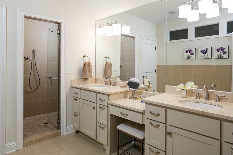 Master Suite Bathroom With Dual Vanities, Make Up Vanity, Crema Marfil  Marble Countertops And