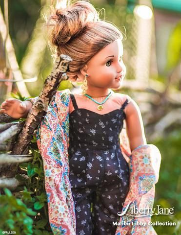Love this shot of the Liberty Jane Malibu Libby: Jumpsuit! The boho style is captured beautifully! Make this look for your American Girl doll using the sewing pattern found at Pixie Faire. #girlcraft #americangirldollcrafts