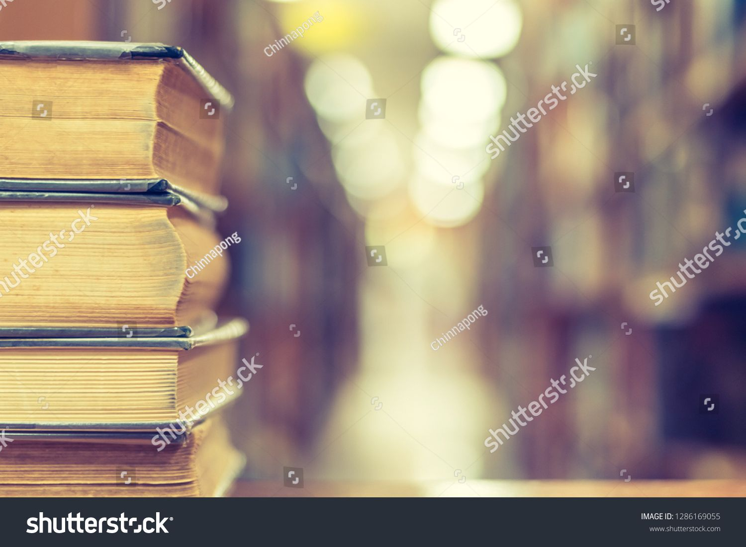 Book stack in library study room with bookshelf for business and education background, class learning and back to school concept ,