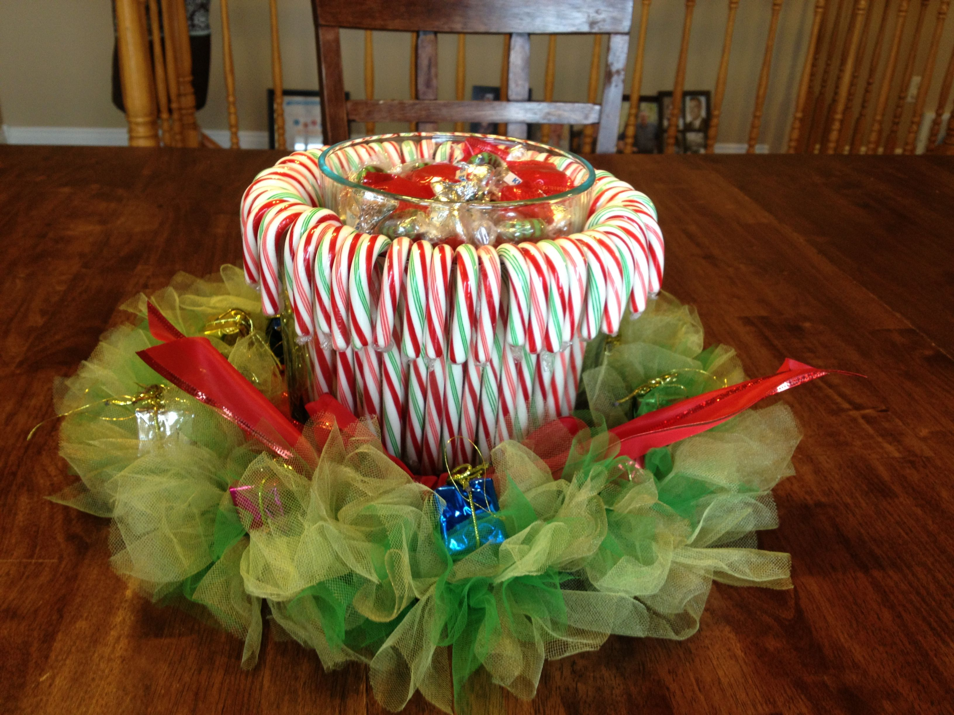 A fun and festive centerpiece with candy canes around the trifle