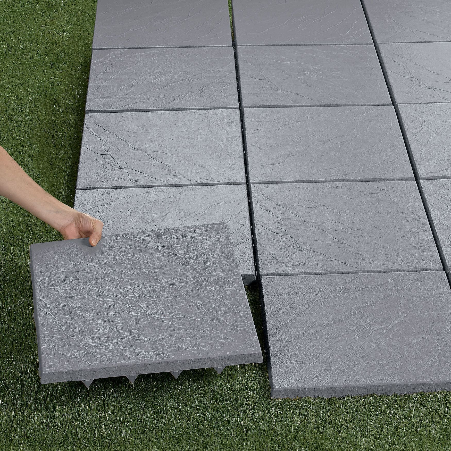 Create an instant patioon any grass, dirt or sand surface
