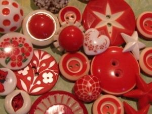 red buttons by mae