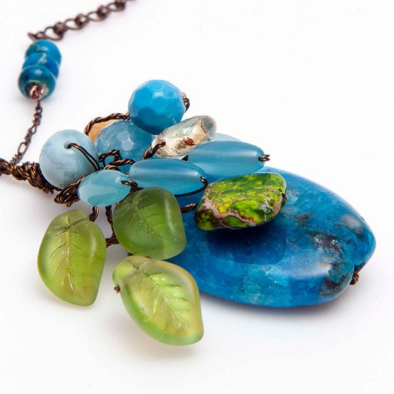 Blue and Green Beaded Necklace is a multi gemstone necklace designed as a beautiful bouquet of gemstones and leaves. The bouquet consists of