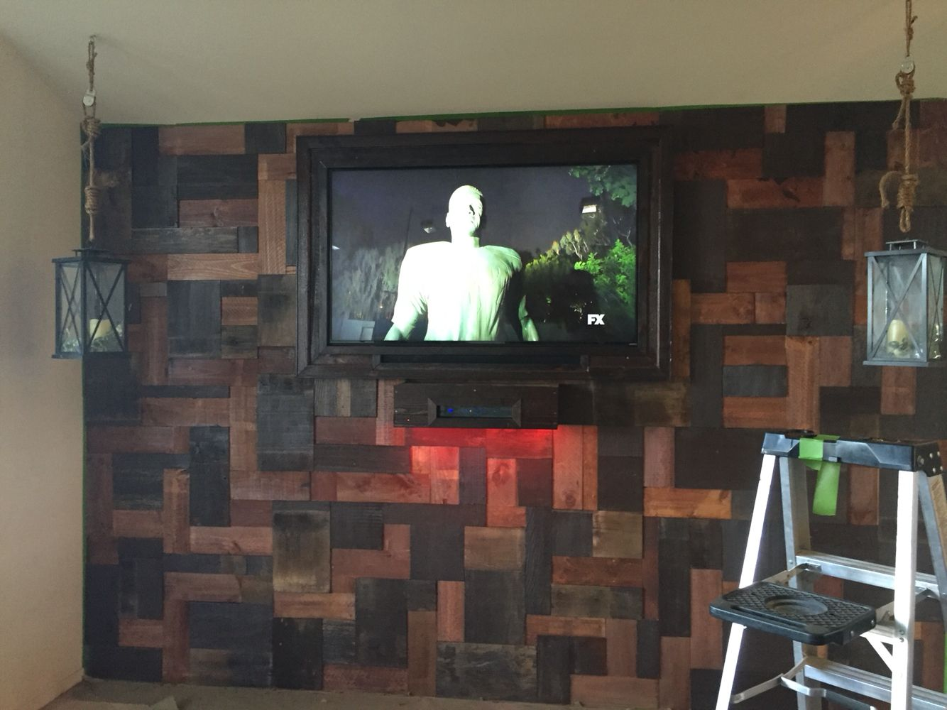 Here is the after shot. Reclaimed style wall, with a floating shelf ...