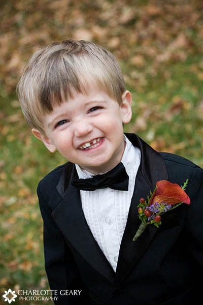 Ring Bearer In Tuxedo With Bow Tie And Mango Calla Lily Boutonniere