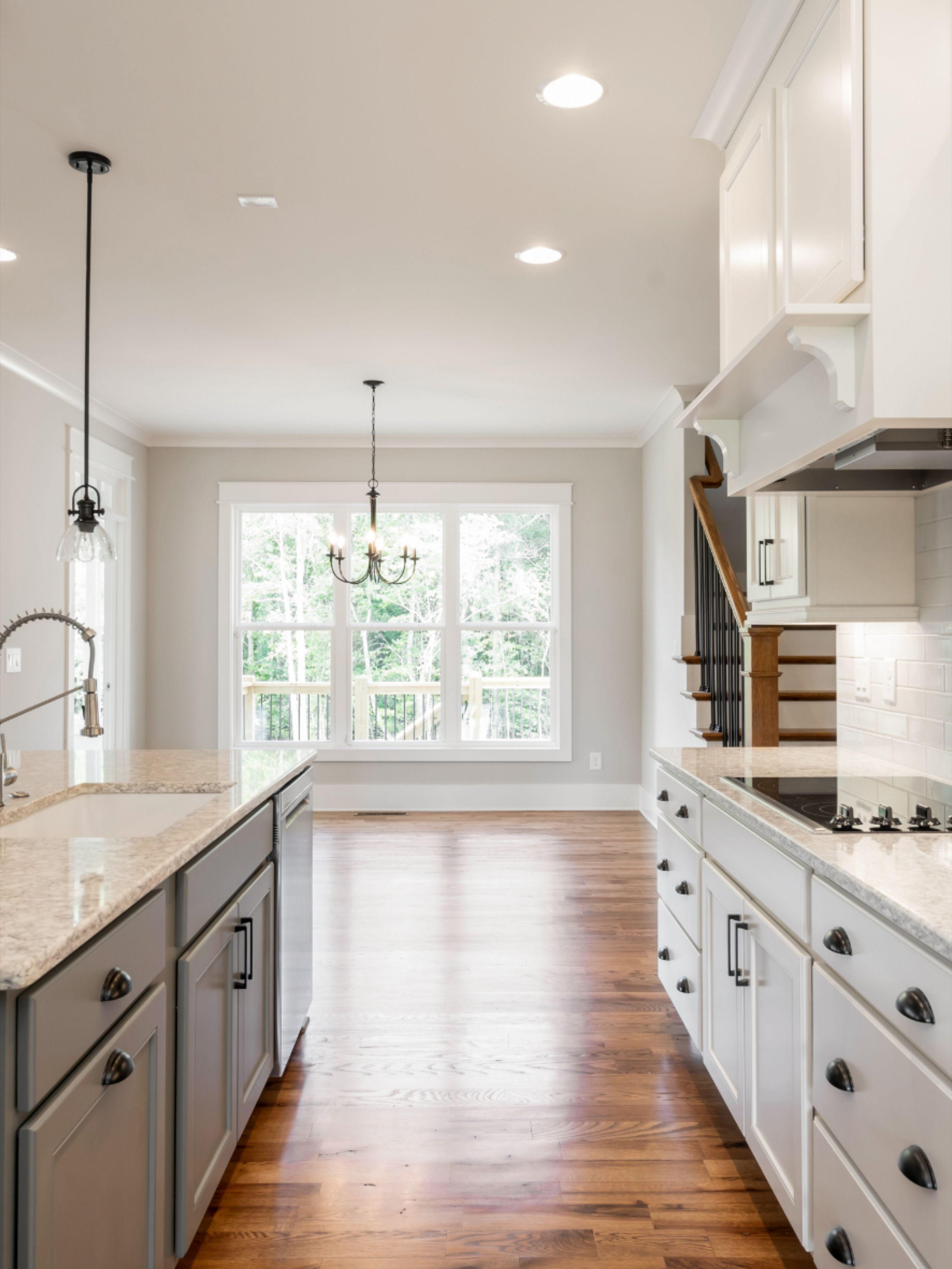 Barn Doors. Grey kitchen island. White trim. White ...
