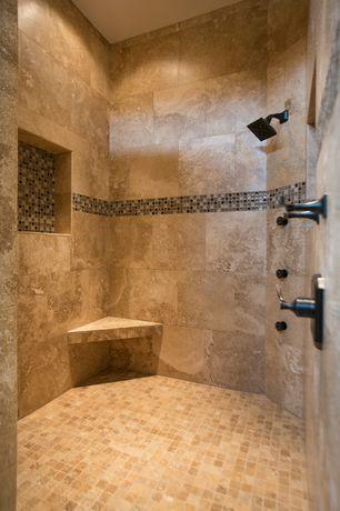 mediterranean master bathroom with ms international ivory