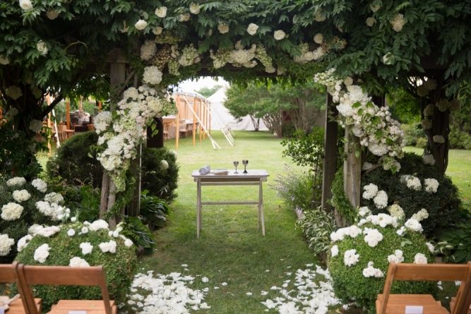 Wedding Ceremony, Private Residence, Flowers by: Matthew Robbins Design, Designed by: Matthew Robbins Design, Photo: Ira Lippke Studios - Bridgehampton Wedding  http://caratsandcake.com/jessieandjett