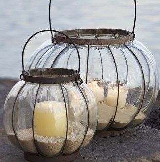 Sand in lantern is inexpensive and can be found anywhere......gives an amazing coastal chic look for any room.