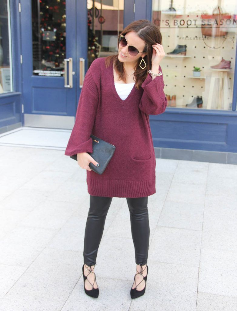 fa764a5e5ec Houston fashion blogger wears a tunic sweater with leather leggings and  laceup heels.