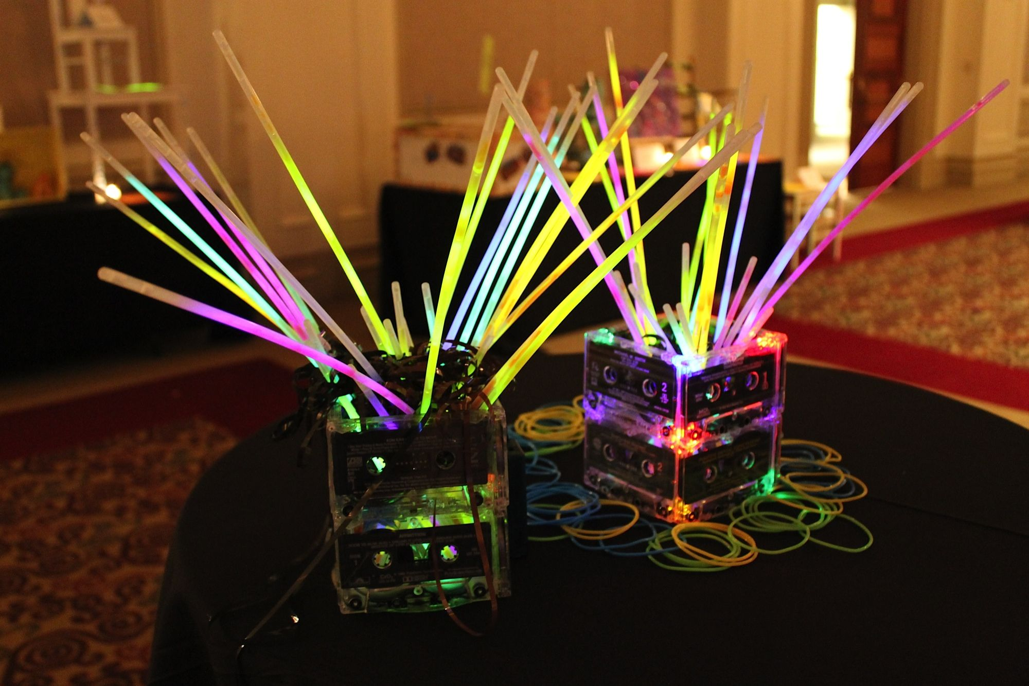 80s Gala Centerpieces Ripped Apart Old Tape Cassettes Stuffed Them Into These Centerpieces With 80s Party Decorations 80s Theme Party 80s Birthday Parties