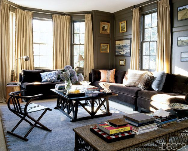 Light Brown walls Dark brown couches Light curtains