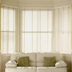 White Blinds Make The Room Much Lighte While Blocking Direct Sun