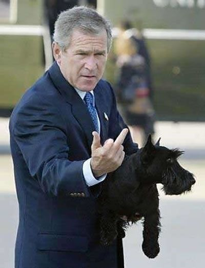 President George W. Bush flipping the bird when he does it you know it - when Obama does it he has to pretend to itch his face - if you are going to flip a bird do it right!!!