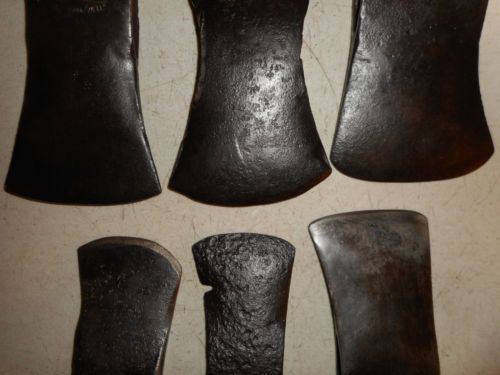 "1. True Temper Kelly Works Zenith Marshall Wells double bit swamping axe head is 11 1/2"" long, 4 1/2"" wide, weighs 4 lbs 1.7 ozs. 2. double bit axe head marked ""A"" and ""2"",  is 9 1/8"" long, 4 3/4"" and 4 7/8"" wide, weighs 4 lbs 1.1 ozs.  3. single bit axe head 7 3/8"" long, 4 5/8"" wide, weighs 3 lbs 7.6 ozs. 4. single bit axe head marked ""P""  6 3/8"" long, 3 1/2"" wide, weighs 2 lb 3.1 ozs. 5. single bit hatchet/axe head is 5"" long, 3 1/4"" wide, weighs 1 lb 6.2 ozs. 6. hatchet head is 4 7/8""…"