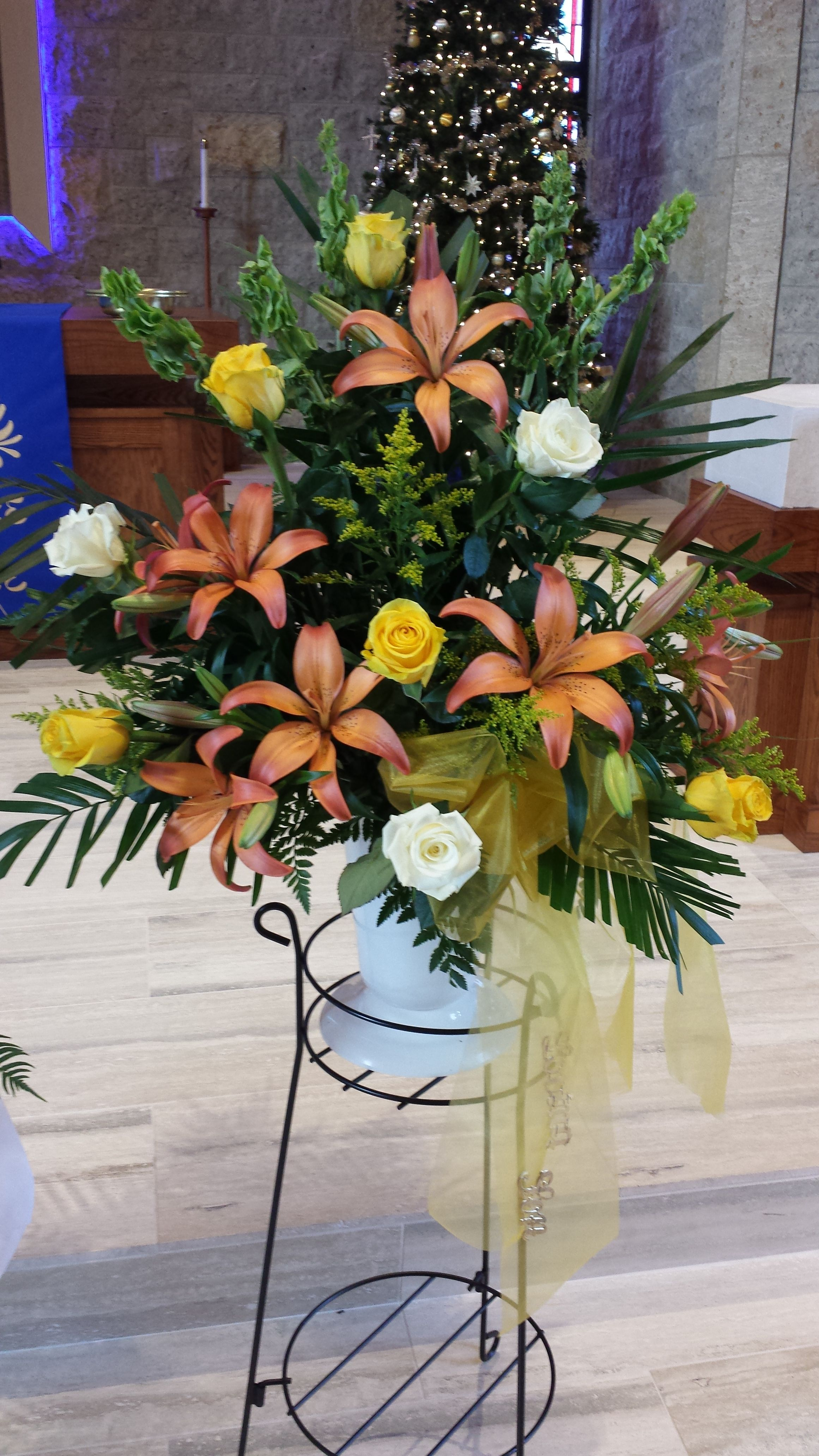 Large funeral spray featuring lilies roses and bells of ireland large funeral spray featuring lilies roses and bells of ireland izmirmasajfo