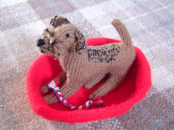 Hand Knitted Border Terrier In A Basket With Tugga Toy With