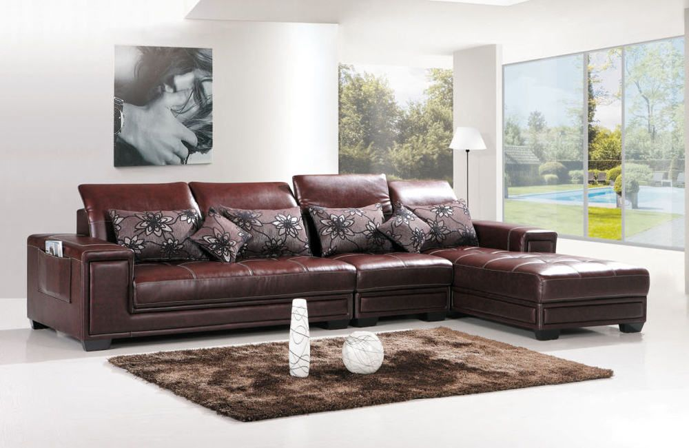 Spacious Living Room Interior Design With Brown L Shaped Leather Sofa  Furniture Using Floral Sofa Pillowcase And Brown Fur Rug Above White  Flooring Also ...