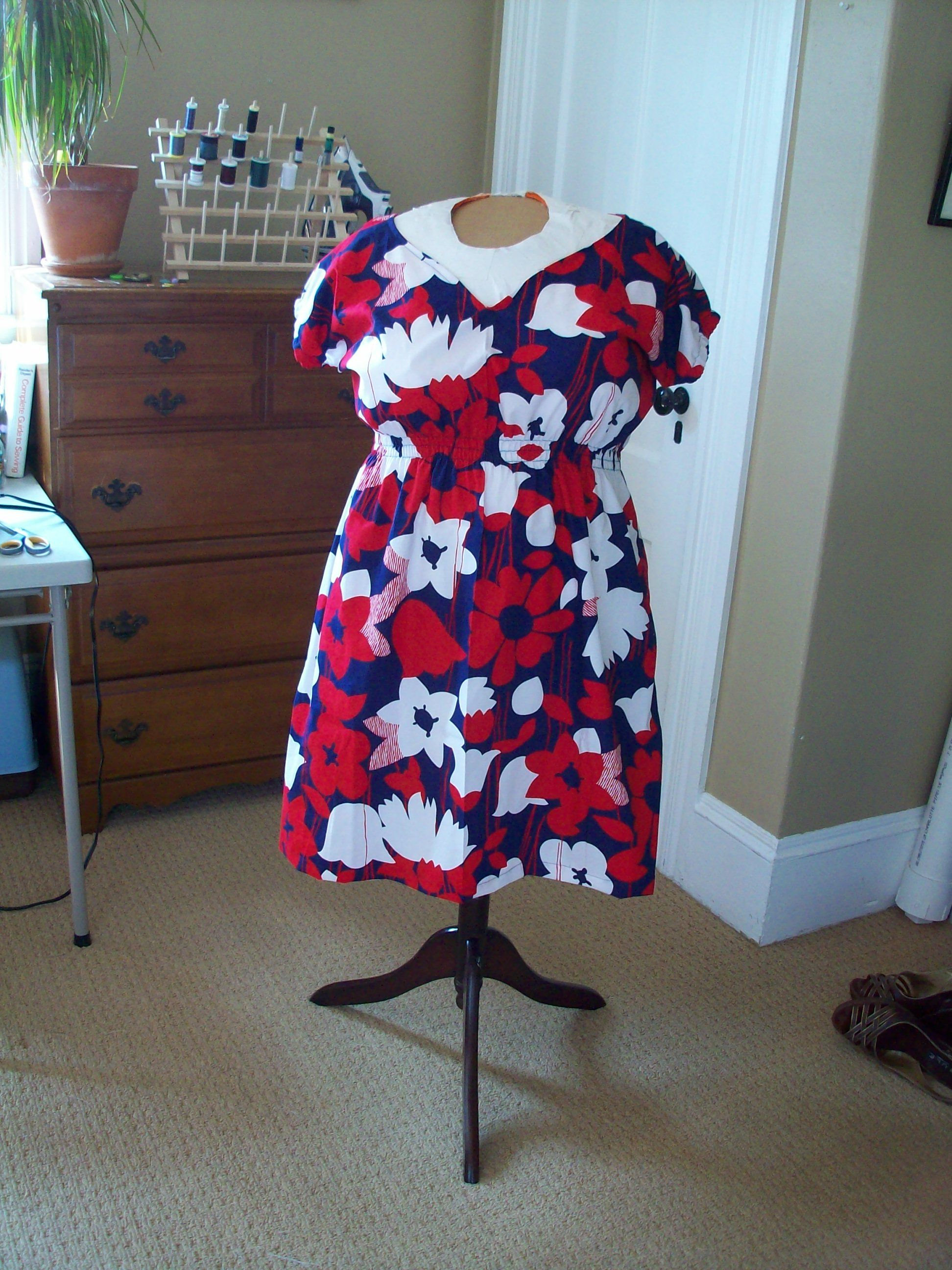 A dress with cinched waist, using elastic thread. Tutorial here: http://www.prudentbaby.com/2010/04/most-flattering-shirt-dress-diy.html.