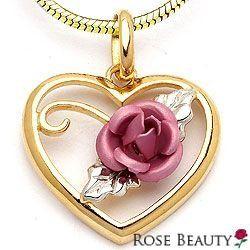 Ruusu Kauneus sydänriipus hopeaa ja kullattua hopeaa