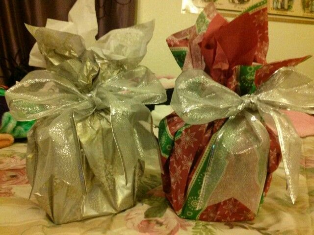 Gift wrapping presents with tissue paper