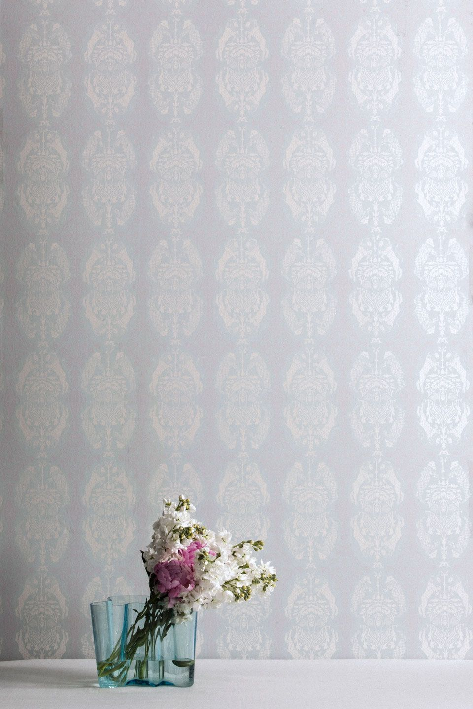 Beastly Guardians in Swan is a hand printed wallpaper that is printed with pearl, light dusty pink, and light blue inks.
