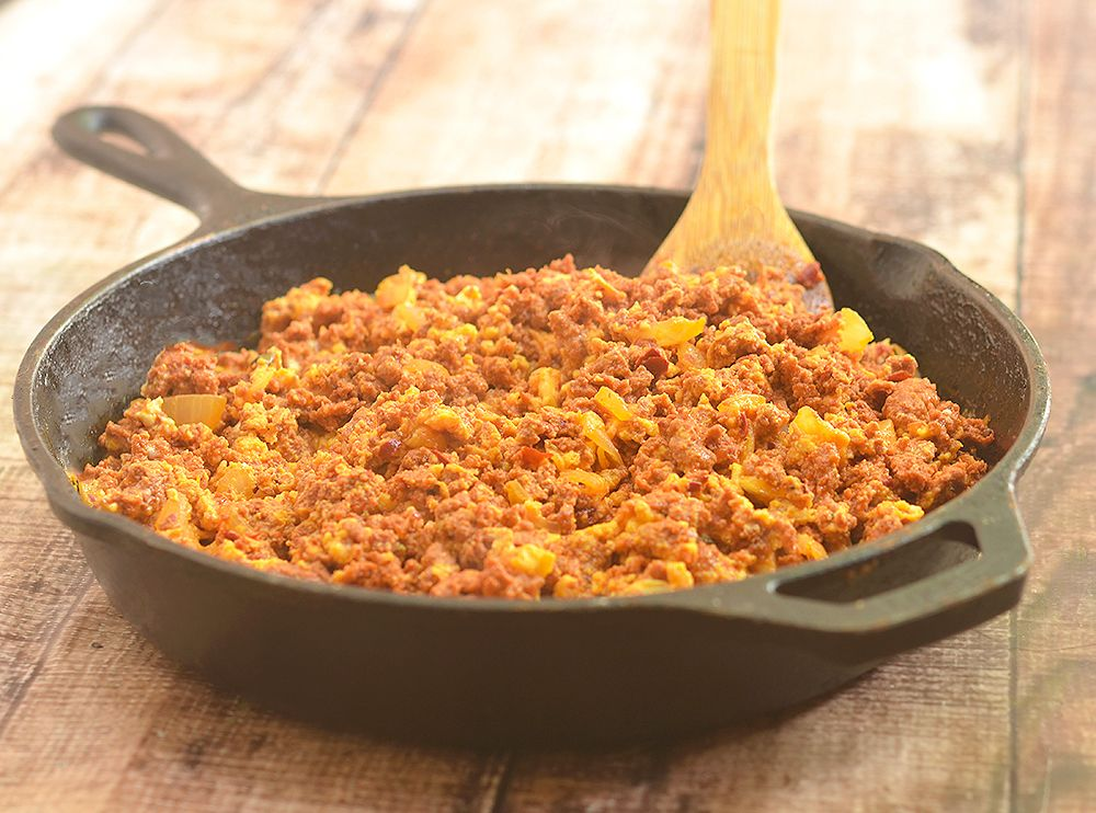 Chorizo con Huevos are crumbled Mexican sausages with scrambled eggs. Hearty and delicious, it's perfect paired with Spanish rice and beans for breakfast as well as fillings for tacos, enchiladas or burritos.