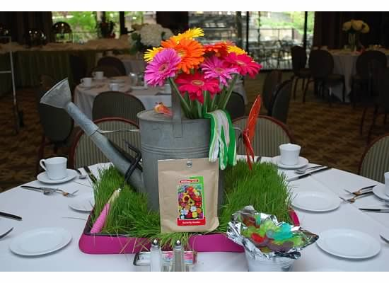 April showers bring may flowers water can centerpieces for Flower arrangements for parties
