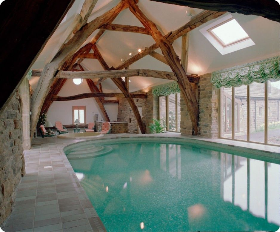 Amazing And Lovely Indoor Swimming Pool Design With Lounge Inside