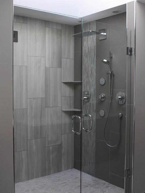 Contemporary large format rectangular tile set vertically for Contemporary bathroom tile designs