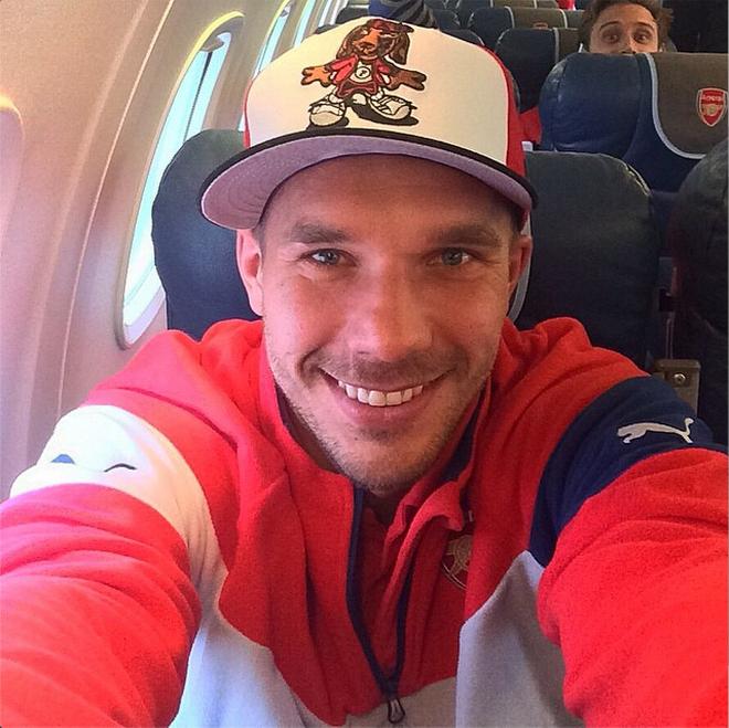 Podolski on the way to Swansea (Monreal photobomb!!)