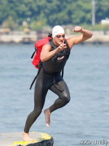 Ryan Lochte, makes one of the most epic pizza deliveries in world history when he leaps from a moving watercraft into the Hudson River, and swim-delivers Pizzeria Pretzel COMBOS® to expectant fans at the Midtown Ferry Terminal. August 20, 2013.