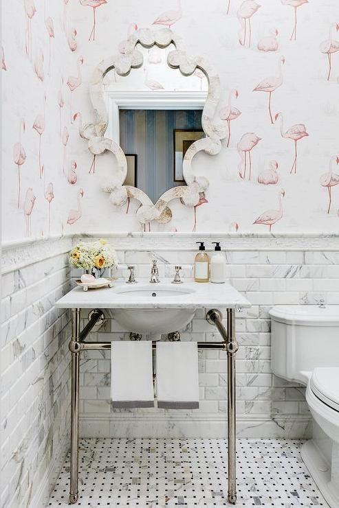 Photo of Lovely white and pink girls' bathroom features a bone inlay mirror hung from a w…