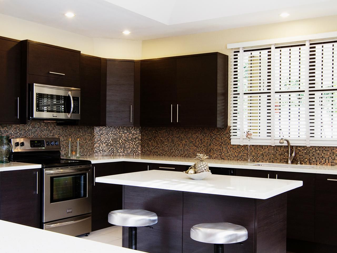Best Dark Brown Cabinetry Is Paired With White Countertops In 400 x 300