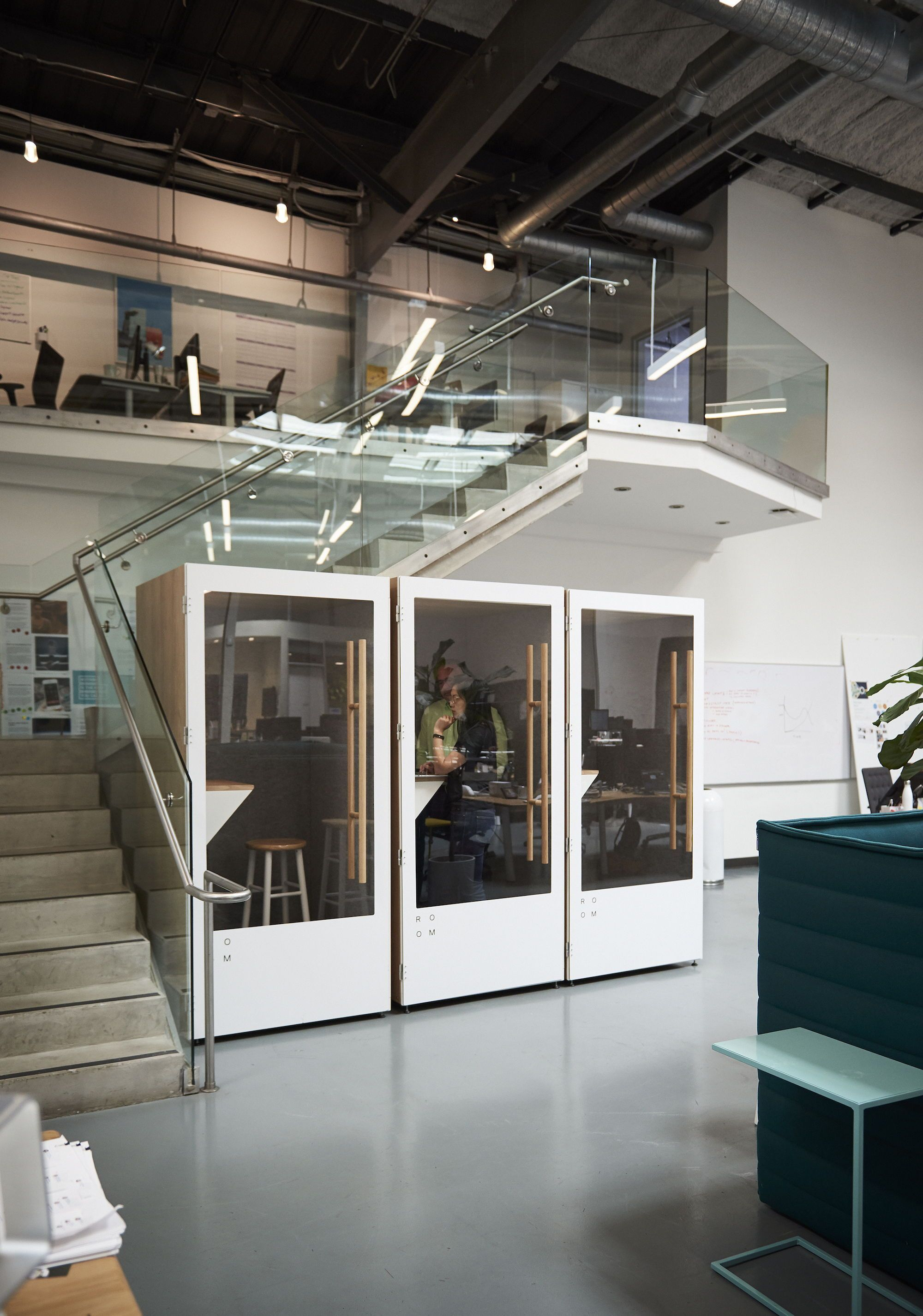 Create sound privacy in the open office minimizing distractions and improving employees health and job satisfaction commercial office design ideas