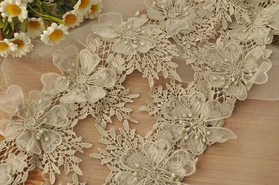 * Chic and delicate 3D lace trim, available in ivory, silver and gold .  * There are 3 layers on each petals, with scalloped chiffon petals, each rosette is about 8 x 11 cm  * You can but and use as applique pair too, there are about 11 rosette flowers on one yard .  * Since it is gold and silver thread, not dyed color, so the price for gold and silver is little higher .And each chiffon petal is sealed with thread quite well, making it more delicate and graceful .  * Price is for one yard…